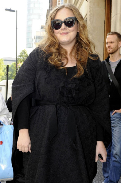 "Adele smiles and poses for a photo as she leaves Radio One Studios after appearing as a guest on ""The Chris Moyles Show.""."