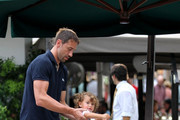 Marko Jaric plays with daughter Valentina (b. November 15, 2009) before dinner with wife Adriana Lima at Cantinetta.