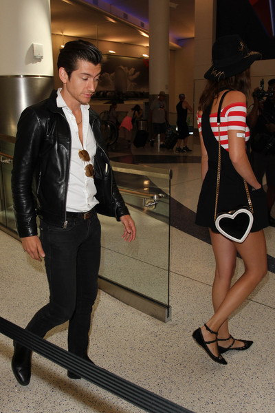 Alex Turner and Arielle Vandenberg are seen at LAX