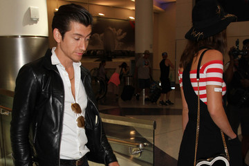 Alex Turner Alex Turner and Arielle Vandenberg are seen at LAX
