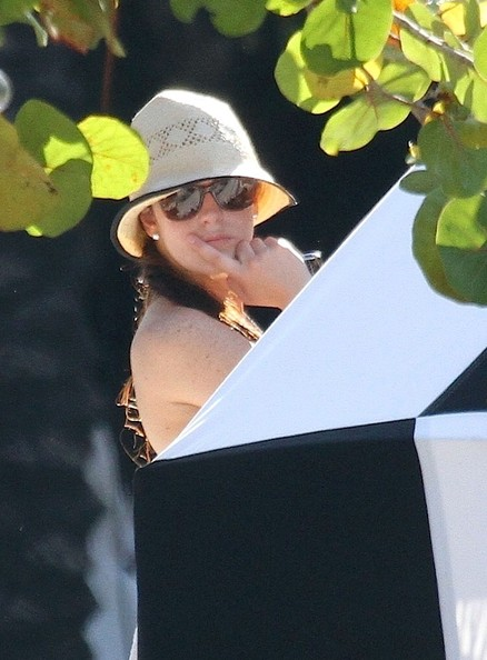 Ali Lohan Lindsay Lohan wears a striped bikini as she relaxes with friends ...
