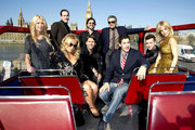 The cast of 'American Reunion' use the Tower Bridge and Westminster Abbey as their background during a photocall aboard a red double decker bus.