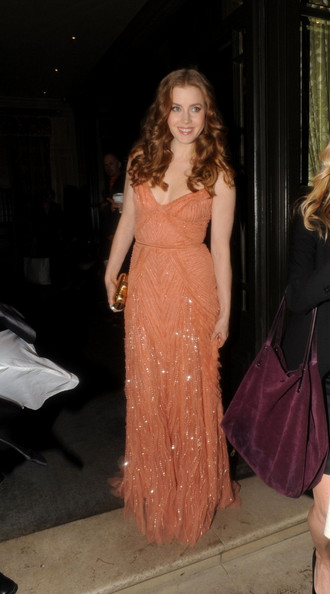 Amy Adams Celebrities leave to attend the 2011 Orange British Academy Film Awards.
