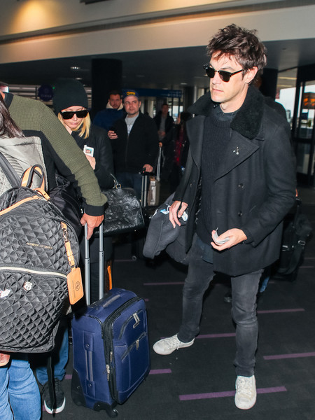Ashley Tisdale And Christopher French At LAX