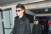 Ashley Tisdale and Christopher French are seen at Los Angeles International Airport in Los Angeles, California.