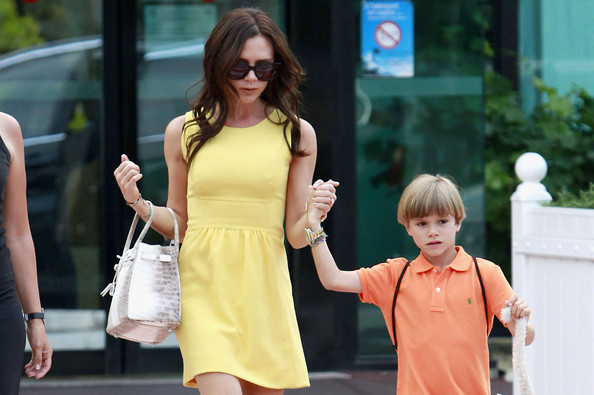 victoria beckham is pregnant again. Beckham's bright arrival Victoria Beckham arrives by private jet in a bright