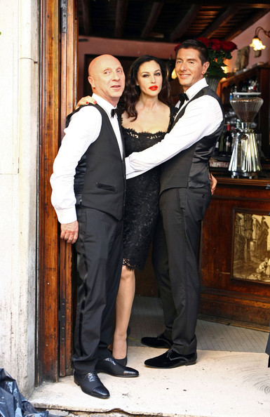 "Monica Bellucci continues filming a commercial for Martini Gold while wearing a Dolce & Gabbana dress. Today's scene includes the designing duo, Domenico Dolce and Stefano Gabbana, dressed as waiters as Bellucci continues the shoot's theme of recreating ""An American Girl in Italy."" Bellucci also brings newborn daughter Leonie (b. May 21, 2010) to set."