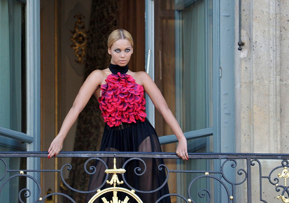 Beyonce looks fierce on the balcony of the Hotel Ritz as she poses for a Harper's Bazaar photo shoot.