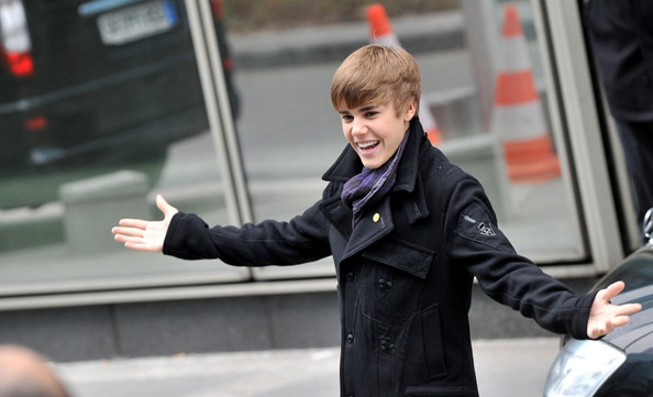 Bieber's open arms Justin Bieber arrives at the NRJ radio station with open