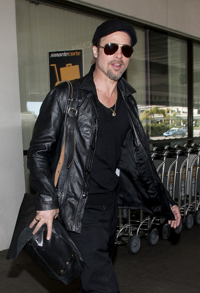 Brad Pitt Arrives at LAX