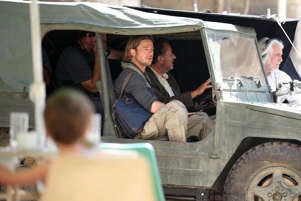 Brad Pitt takes a moment to wave hello and smile for two little Maltese girls called Riana, 6 and Tatiana, 4 outside Zanzu Photography Studio which had been converted into cafe Hayir for the film World War Z. Brad is filming a scene where he drives through a village in a big jeep.