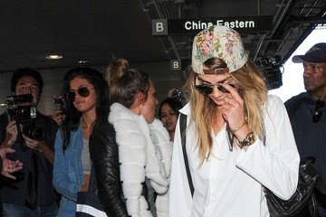 Cara Delevingne Selena Gomez and Cara Delevingne at LAX