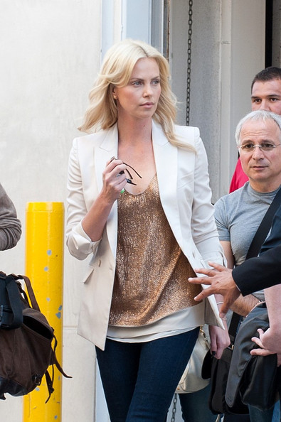 Charlize Theron leaves the Hilton Hotel to head over to Comic Con.