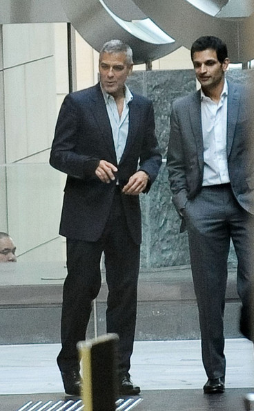 George clooney looks dapper in a black suit as he goes to star city