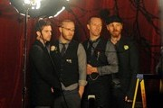 """Coldplay (Chris Martin, Will Champion, Jonny Buckland, Guy Berryman) film a new music video in the South Bank with some """"Elvis"""" impersonators."""