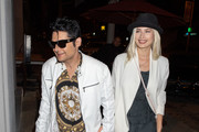 Corey Feldman and Courtney Anne Mitchell are seen at Craig's restaurant in Los Angeles, California on April 25, 2019.