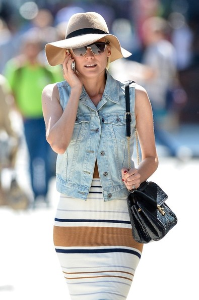 BYLINE: EROTEME.CO.UK.Diane Kruger wears a denim vest with a skirt as she chats on her cellphone while out in the Bowery.