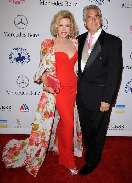 Caption: Donna Mills and Richard Holland. Donna looks stunning with her sexy gown.
