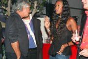 Flavio Briatore flirts with his ex-fling Naomi Campbell as his girlfriend looks on at the  Circus of the Sun party in Boulogne, France.