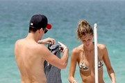 ***NO CANADA RIGHTS***.Jared Followill and his fiancee Martha Patterson slip back into their clothes and head indoors after spending the afternoon on the beach.