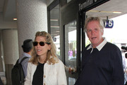 Gary Busey and Steffanie Sampson Arrive at LAX