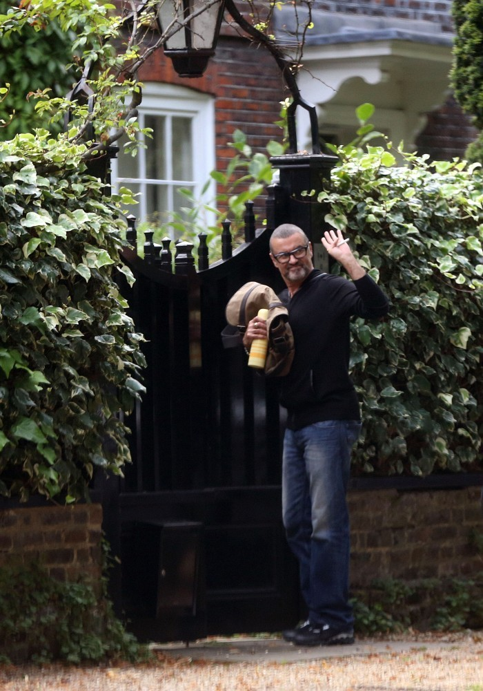 george michael photos photos george michael arrives home zimbio