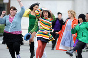 """The cast of """"Glee"""" film a song and dance number in Washington Square Park."""