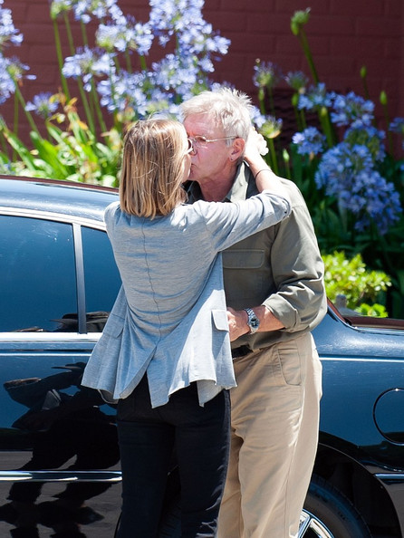 Harrison Ford Harrison Ford kisses his wife, Calista Flockhart, 3 days after their first wedding anniversary.  They were spotted at son Liam's baseball game (born January 1, 2001).  Harrison gives Liam a chocolate cupcake before wife and son depart in a limousine.
