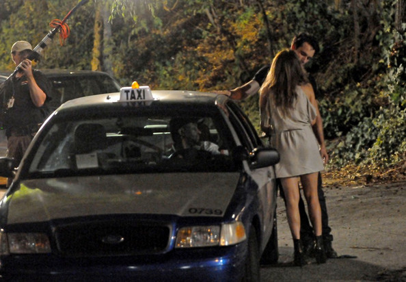 "Jennifer Lopez and Rodrigo Santoro film a night scene for ""What to Expect When You're Expecting."" In this scene Lopez' character appears to be distressed as she stumbles to an awaiting cab."