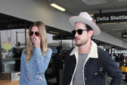 Jared Followill and Martha Patterson are seen at LAX.