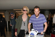 Jenna Elfman and Bodhi Elfman Are Seen at LAX