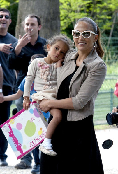 Jennifer Lopez Jennifer Lopez, along with her mother Guadalupe Lopez, takes her twins, Emme and Max (b. February 22, 2008) to the Parc Monceau where they play on the carousel and swings and the twins are treated to new toys.