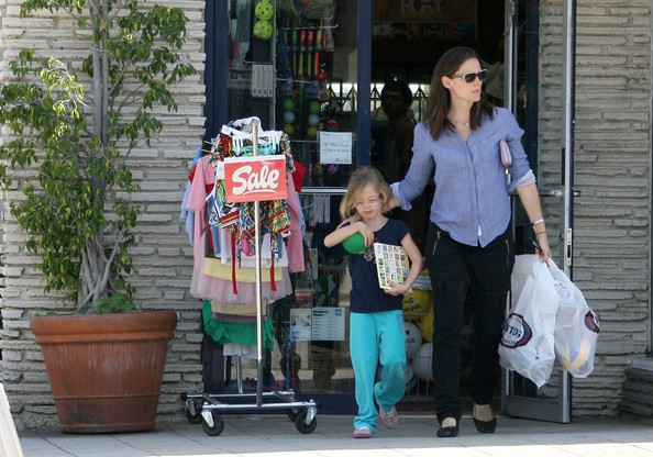 Jennifer Garner gives her daughter, Violet (b. December 1, 2005) a lift as the two make their way to Bentons Sporting Goods Store in Pacific Palisades. When they emerge from their shopping trip Violet is sporting a new green ball.