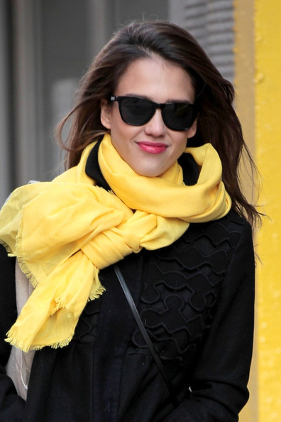 Jessica Alba Jessica Alba wears a bright yellow scarf, adding a pop of color to her otherwise all black ensemble.
