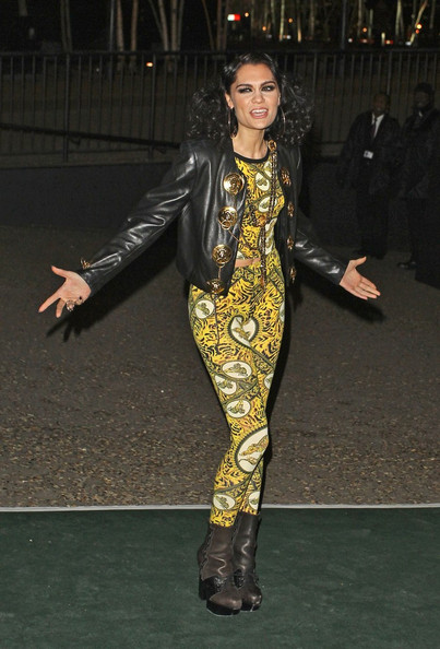 Jessie J Jessie J wears a leather jacket and a bold yellow spandex jumpsuit to the  BRIT Awards 2012 afterparty at the Tate Modern .