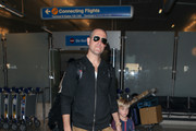 Jim Toth with son Tennessee James Toth are seen at Los Angeles International Airport.