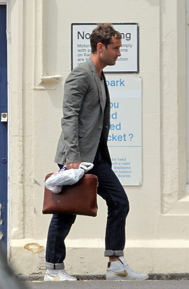 Jude Law takes a train from