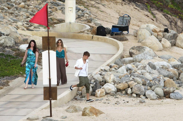 Justin Bieber Selena Gomez acts as a bridesmaid for her friend Shannon Larossi's beach side wedding ceremony. Whilst off duty she cuddles up to boyfriend Justin Bieber .NON- EXCLUSIVE December 08, 2011.
