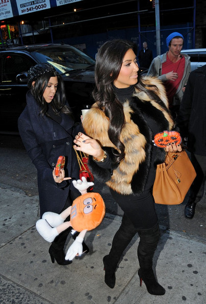 Kourtney and Kim Kardashian leave a Midtown recording studio.  On the way out, they are given some Halloween candy and gifts from a fan.