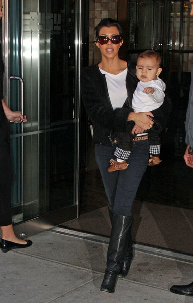 Kim Kardashian, sister Kourtney, her baby Mason Dash Disick (b. Dec 14, 2009) and boyfriend Scott Disick, depart from JFK International Airport.