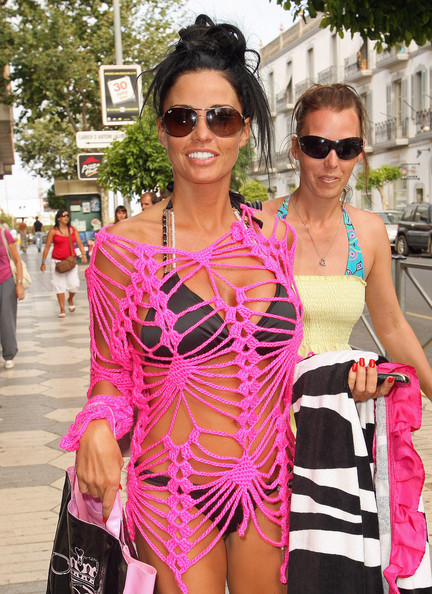 Katie Price looks ready for the beach as she shops around town with a friend.