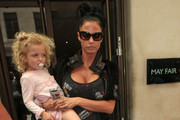 Katie Price leaves the May Fair Hotel & arrives at Radio 2 with her daughter Princess Tiaamii.  Carrying her bling i phone cover that says 'I love ALEX'.