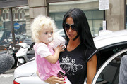 Katie Price (aka Jordan) is spotted shopping around in an interesting outfit before going to the Radio 2 station with daughter Princess Tiaamii (b.