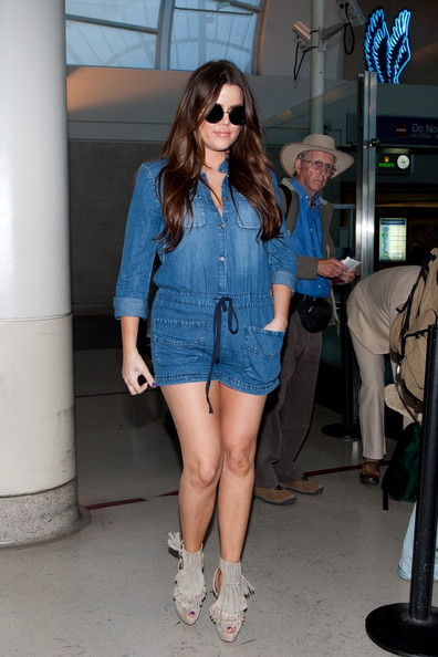 Khloe Kardashian arrives at LAX (Los Angeles International Airport) looking fashionable and stylish.