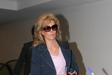 Kim Basinger Kim Basinger and Mitch Stone Are Seen at LAX