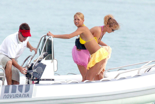 ... adjusting her little yellow bikini while. Anna Kournikova on a Yacht
