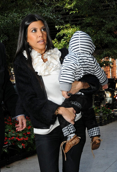 Kourtney Kardashian Kourtney Kardashian carries baby Mason Dash Disick (b. Dec 14, 2009) into a friend's apartment in Midtown.