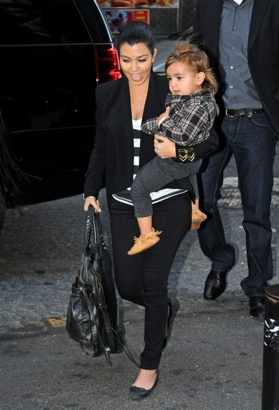 Kourtney Kardashian Kourtney Kardashian carries her son Mason Dash Disick (b. Dec 14, 2009) into their downtown hotel.
