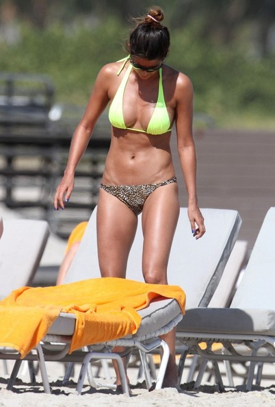 With her athletic body and Brown/Black hairtype without bra (cup size 36C) on the beach in bikini
