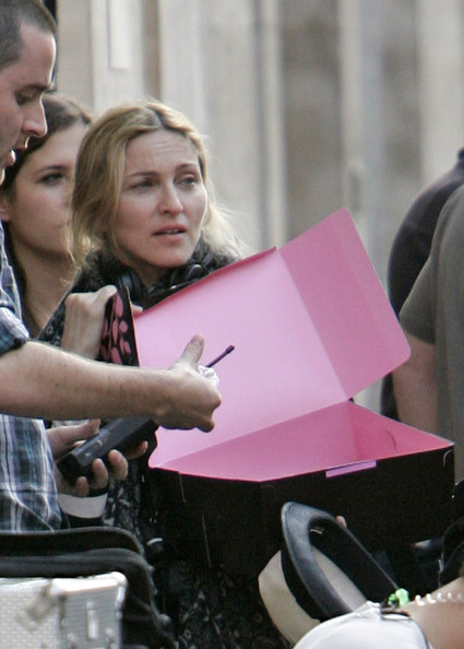 "Madonna looks fed up and tired as she continues directing her new film ""WE""? a two-tiered romantic drama starring Abbie Cornish."